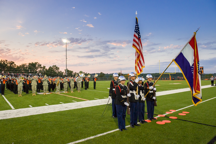 The Waynesville High School band and the 399th Army band perform before a WHS football game